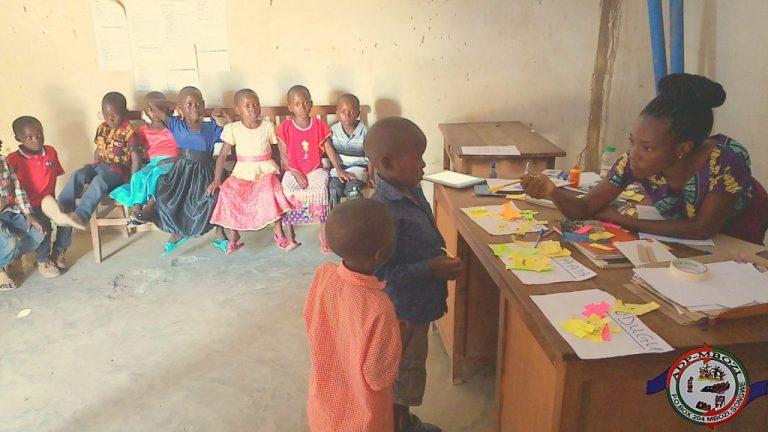 Cards-brain teaser game to 4-6 Children during Qualitative data collection at Nanyala village – Nanyala ward.